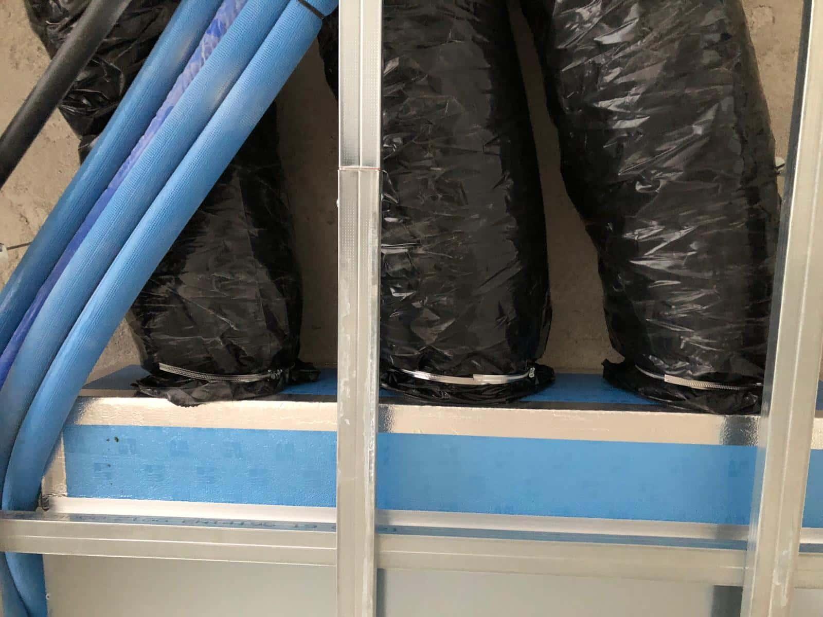 Impianto di trattamento aria abitazione con distribuzione tramite tubazione flessibile isolata 1